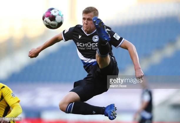 Joakim Nilsson of Arminia Bielefeld controls the ball in the air during the Bundesliga match between DSC Arminia Bielefeld and Borussia Dortmund at...