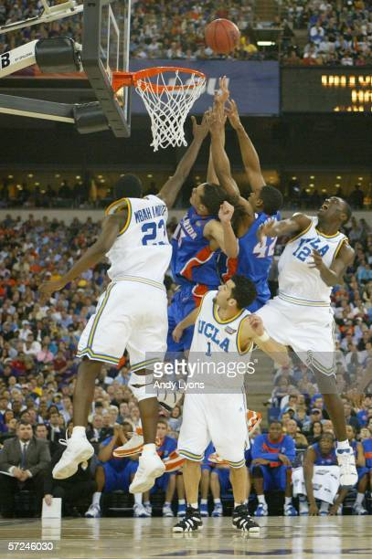 Joakim Noah and Al Horford of the Florida Gators go up for a rebound against Luc Richard Mbah a Moute, Jordan Farmar and Alfred Aboya of the UCLA...