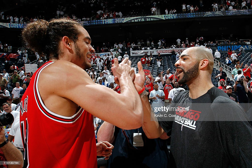 Joakim Noah #13 and Carlos Boozer #5 of the Chicago Bulls celebrate after their 93-73 win over the Atlanta Hawks in Game Six of the Eastern Conference Semifinals in the 2011 NBA Playoffs at Phillips Arena on May 12, 2011 in Atlanta, Georgia.