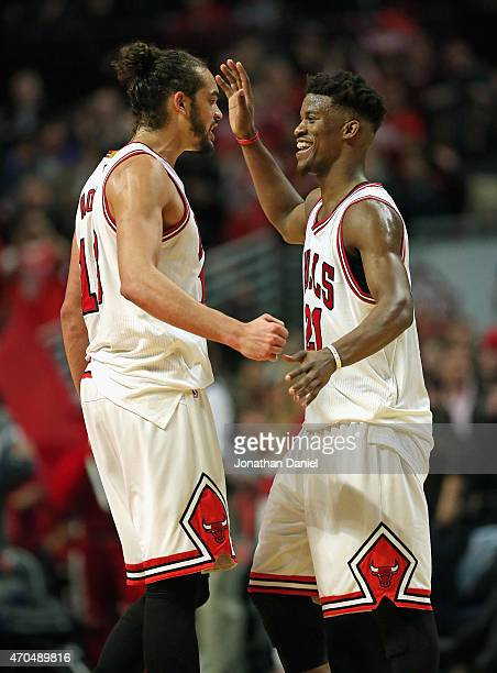 Joakim Noah and Jimmy Butler of the Chicago Bulls celebrate a win over the Milwaukee Bucks during the first round of the 2015 NBA Playoffs at the...