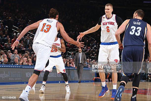 Joakim Noah and Kristaps Porzingis of the New York Knicks high five during the game against the Memphis Grizzlies on October 29 2016 at Madison...