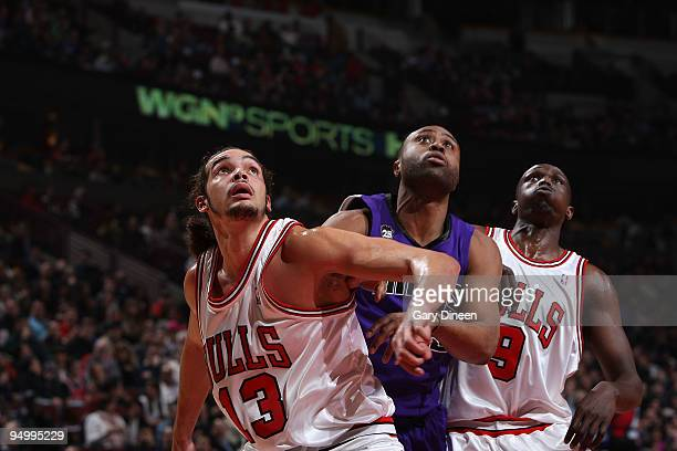 Joakim Noah and Luol Deng of the Chicago Bulls box out Kenny Thomas of the Sacramento Kings during the NBA game on December 21 2009 at the United...
