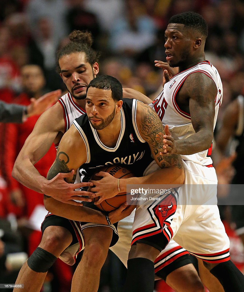 Joakim Noah #13 (L) and Nate Robinson #2 of the Chicago Bulls pressure Deron Williams #8 of the Brooklyn Nets in Game Six of the Eastern Conference Quarterfinals during the 2013 NBA Playoffs at the United Center on May 2, 2013 in Chicago, Illinois. The Nets defeated the Bulls 95-92.