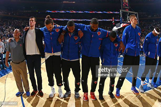 Joakim Noah and the New York Knicks stand on the court for the National Anthem before the game against the Memphis Grizzlies on October 29 2016 at...