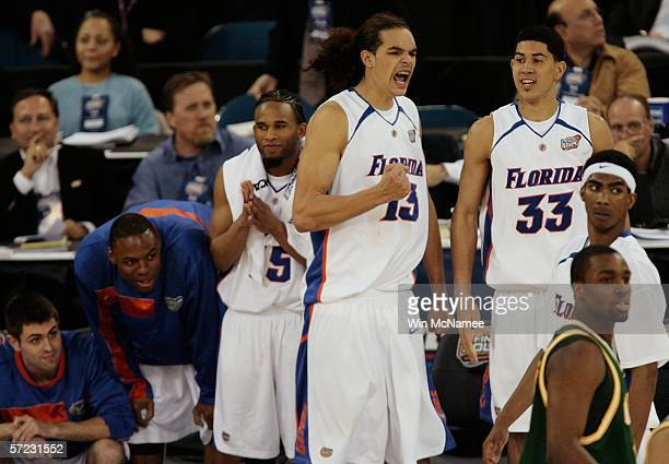 Joakim Noah Jimmie Sutton and David Huertas and the Florida Gators react during the final seconds before defeating the George Mason Patriots 7358 in...