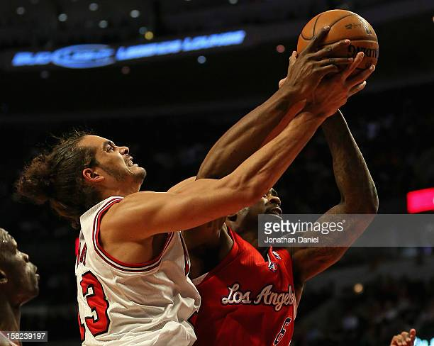 Joakim Noah of the Chicago Bulls and DeAndre Jordan of the Los Angeles Clippers battle for a rebound at the United Center on December 11 2012 in...
