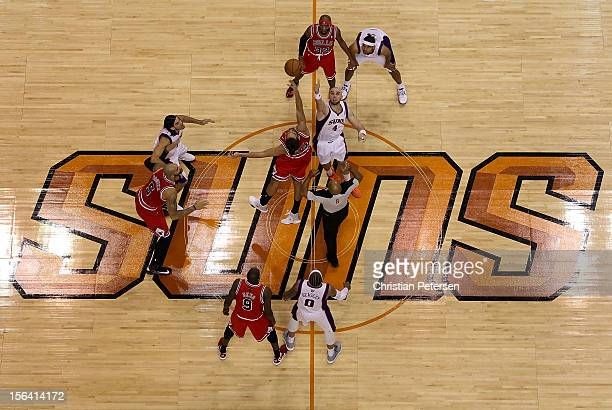 Joakim Noah of the Chicago Bulls and Marcin Gortat of the Phoenix Suns jump for the openning tip off during the NBA game at US Airways Center on...