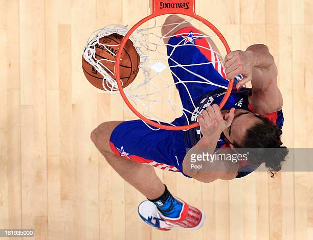 Joakim Noah of the Chicago Bulls and the Eastern Conference dunks the ball in the first half during the 2013 NBA AllStar game at the Toyota Center on...