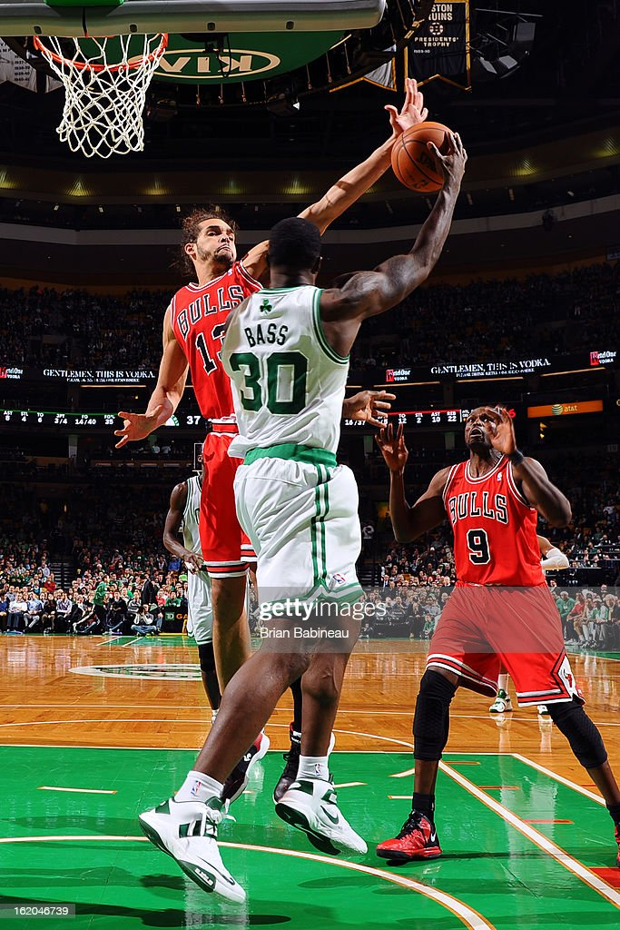 Joakim Noah #13 of the Chicago Bulls blocks a shot against Brandon Bass #30 of the Boston Celtics on February 13, 2013 at the TD Garden in Boston, Massachusetts.