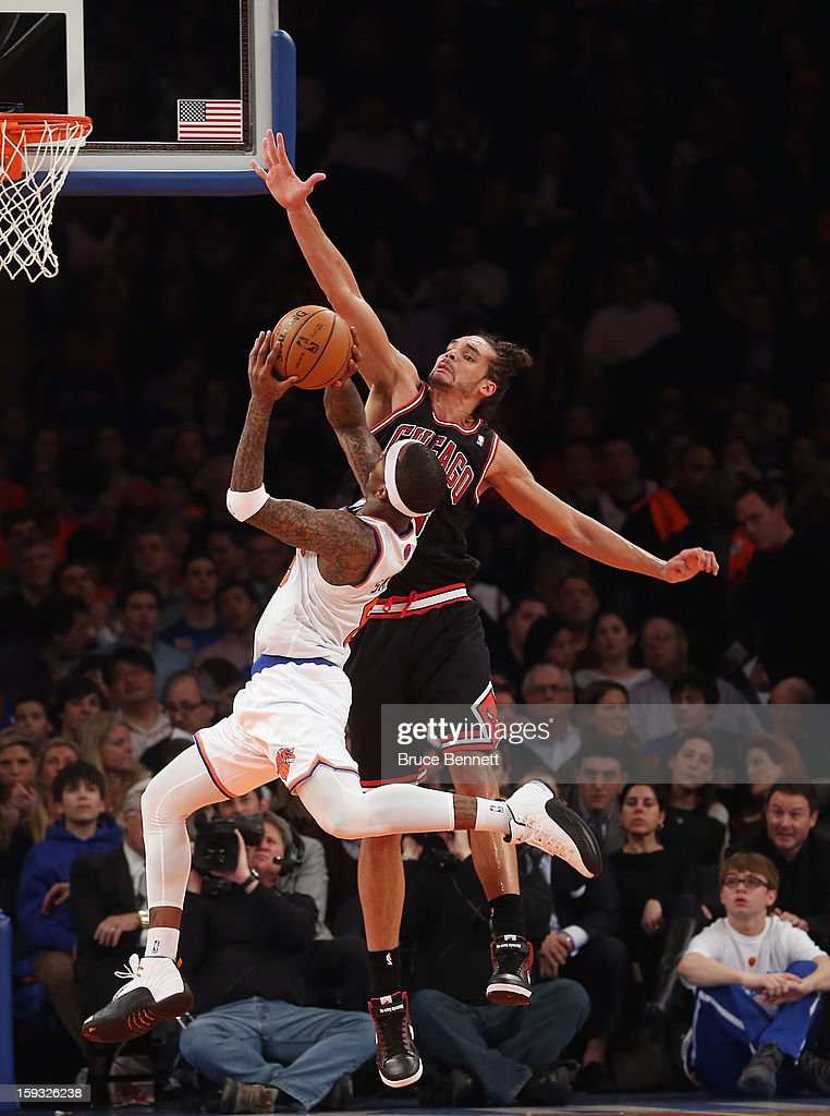 Joakim Noah #13 of the Chicago Bulls blocks a shot by J.R. Smith #8 of the New York Knicks at Madison Square Garden on January 11, 2013 in New York City.