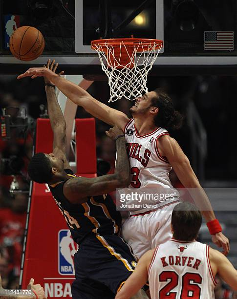 Joakim Noah of the Chicago Bulls blocks a shot by Paul George of the Indiana Pacers in Game Two of the Eastern Conference Quarterfinals in the 2011...