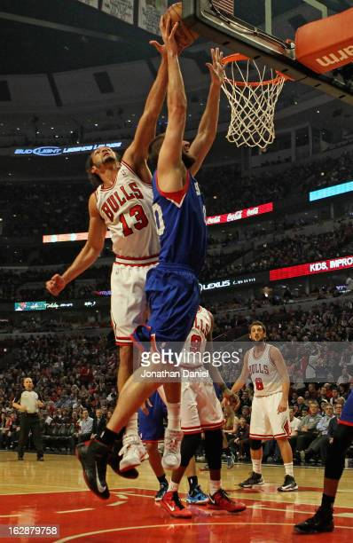 Joakim Noah of the Chicago Bulls blocks a shot by Spencer Hawes of the Phildelphia 76ers at the United Center on February 28 2013 in Chicago Illinois...