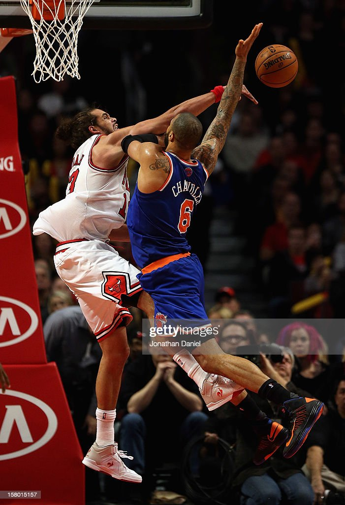 Joakim Noah #13 of the Chicago Bulls blocks a shot by Tyson Chandler #6 of the New York Knicks at the United Center on December 8, 2012 in Chicago, Illinois. The Bulls defeated the Knicks 93-85.