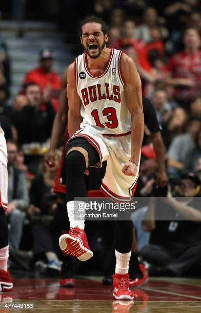 Joakim Noah of the Chicago Bulls celebrates after being fouled during a game against the Miami Heat at the United Center on March 9 2014 in Chicago...