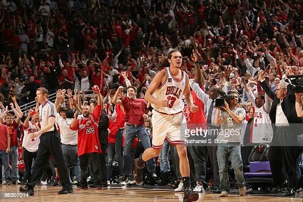 Joakim Noah of the Chicago Bulls celebrates at the conclusion of Game Six of the Eastern Conference Quarterfinals game against the Boston Celtics as...