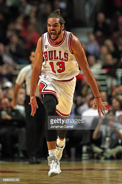 Joakim Noah of the Chicago Bulls celebrates hitting a shot against the San Antonio Spurs at the United Center on November 30 2015 in Chicago Illinois...