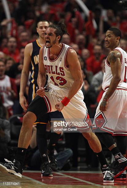 Joakim Noah of the Chicago Bulls celebrates two blocked shots in the final seconds against the Indiana Pacers in Game One of the Eastern Conference...