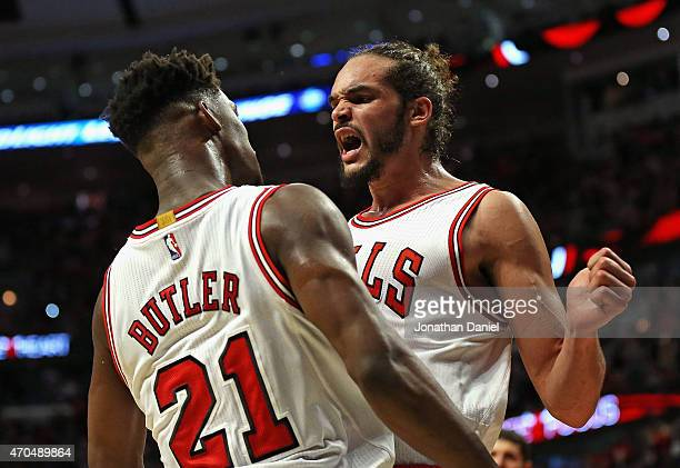 Joakim Noah of the Chicago Bulls chest bumps teammate Jimmy Butler during the first round of the 2015 NBA Playoffs at the United Center on April 20...