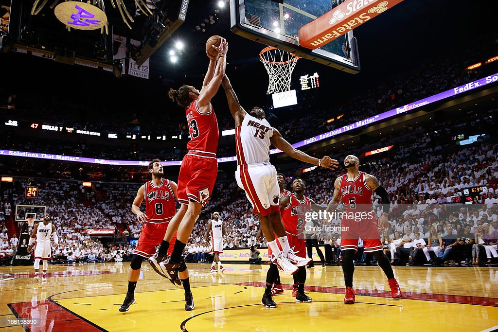 Joakim Noah #13 of the Chicago Bulls competes with Mario Chalmers #15 of the Miami Heat for a rebound during Game One of the Eastern Conference Semifinals of the 2013 NBA Playoffs at American Airlines Arena on May 6, 2013 in Miami, Florida.