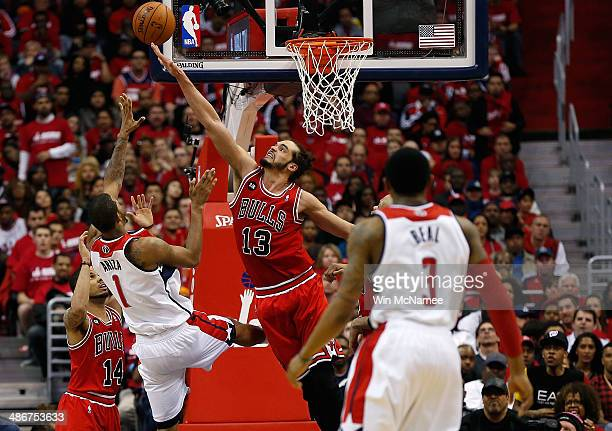 Joakim Noah of the Chicago Bulls defends Trevor Ariza of the Washington Wizards in fourth quarter action of Game 3 of the Eastern Conference...