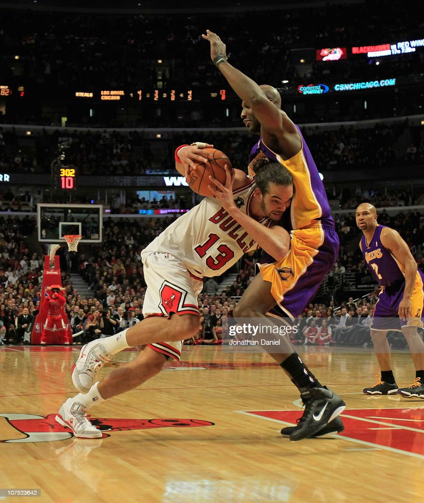 Joakim Noah #13 of the Chicago Bulls drives against Lamar Odom #7 of the Los Angeles Lakers at the United Center on December 10, 2010 in Chicago, Illinois. The Bulls defeated the Lakers 88-84..NOTE