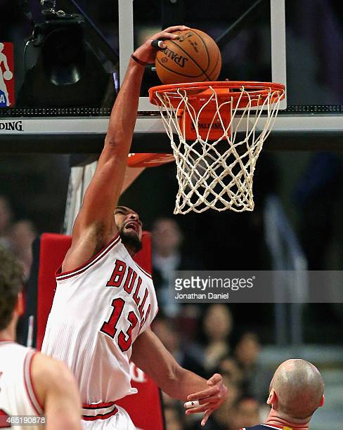 Joakim Noah of the Chicago Bulls dunks against the Washington Wizards at the United Center on March 3 2015 in Chicago Illinois NOTE TO USER User...