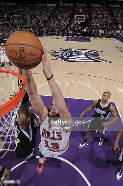 Joakim Noah of the Chicago Bulls dunks the ball against the Sacramento Kings at Sleep Train Arena on November 20 2014 in Sacramento California NOTE...