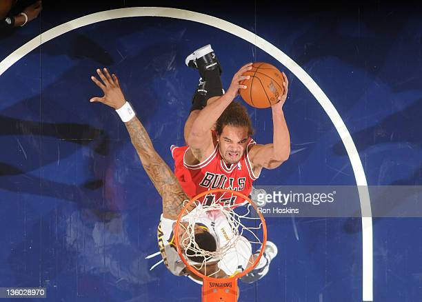 Joakim Noah of the Chicago Bulls dunks the basketball against the Indiana Pacers during the preseason game on December 16 2011 at Conseco Fieldhouse...