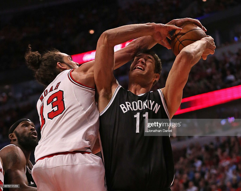 Joakim Noah #13 of the Chicago Bulls fouls Brook Lopez #11 of the Brooklyn Nets in Game Three of the Eastern Conference Quarterfinals during the 2013 NBA Playoffs at the United Center on April 25, 2013 in Chicago, Illinois.