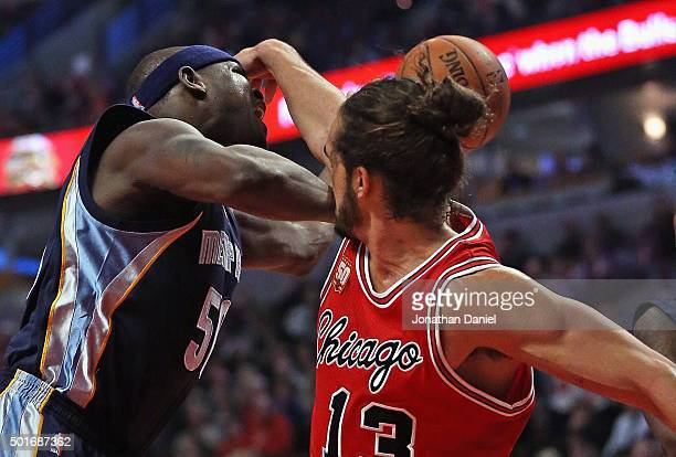 Joakim Noah of the Chicago Bulls fouls Zach Randolph of the Memphis Grizzlies at the United Center on December 16 2015 in Chicago Illinois NOTE TO...