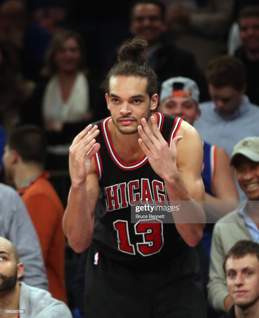 Joakim Noah #13 of the Chicago Bulls gestures after fouling out in the fourth quarter against the New York Knicks at Madison Square Garden on January 11, 2013 in New York City.