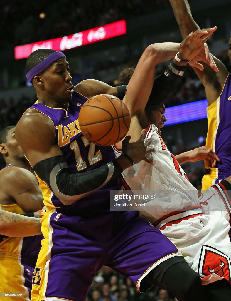 Joakim Noah #13 of the Chicago Bulls gets tangled up with Dwight Howard #12 of the Los Angeles Lakers at the United Center on January 21, 2013 in Chicago, Illinois. The Bulls defeated the Lakers 95-83.