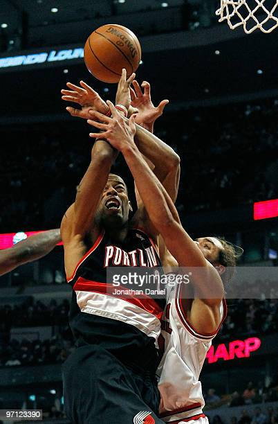 Joakim Noah of the Chicago Bulls gets tangled up with Marcus Camby of the Portland Trail Blazers at the United Center on February 26 2010 in Chicago...