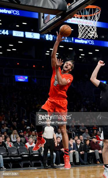 Joakim Noah of the Chicago Bulls goes to the basket during the first quarter against the Brooklyn Nets at the Barclays Center on December 25, 2013 in...