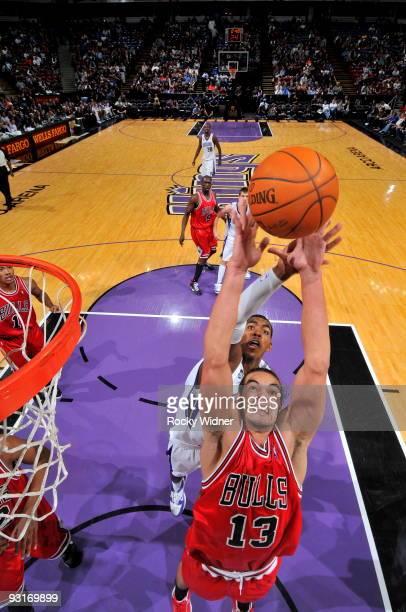 Joakim Noah of the Chicago Bulls grabs the rebound against Jason Thompson of the Sacramento Kings on November 17 2009 at ARCO Arena in Sacramento...