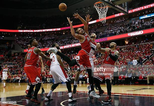 Joakim Noah of the Chicago Bulls has his shot rejected by Marcin Gortat of the Washington Wizards in first quarter action of Game 3 of the Eastern...
