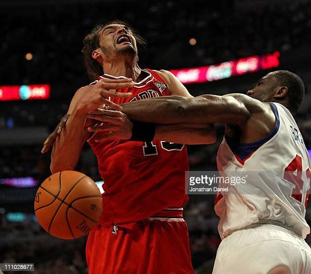 Joakim Noah of the Chicago Bulls is fouled by Elton Brand of the Philadelphia 76ers at the United Center on March 28 2011 in Chicago Illinois The...