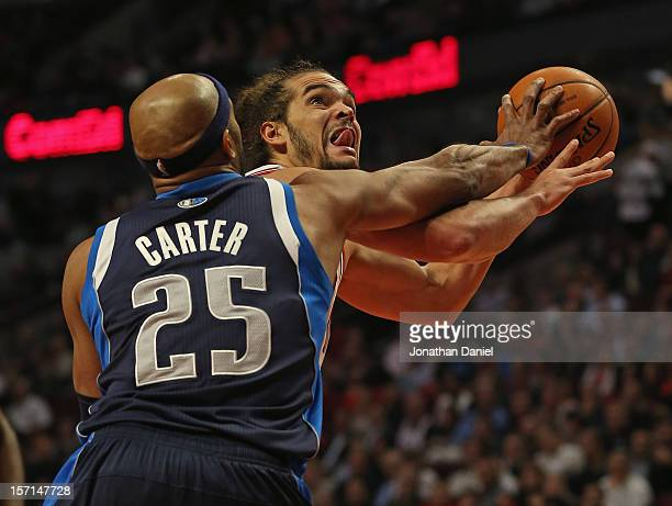 Joakim Noah of the Chicago Bulls is fouled by Vince Carter of the Dallas Mavericks at the United Center on November 28 2012 in Chicago Illinois The...