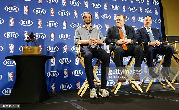 Joakim Noah of the Chicago Bulls left sits next to Chicago Bulls Head Coach Tom Thibodeau center and Chicago Bulls General Manager Gar Forman before...
