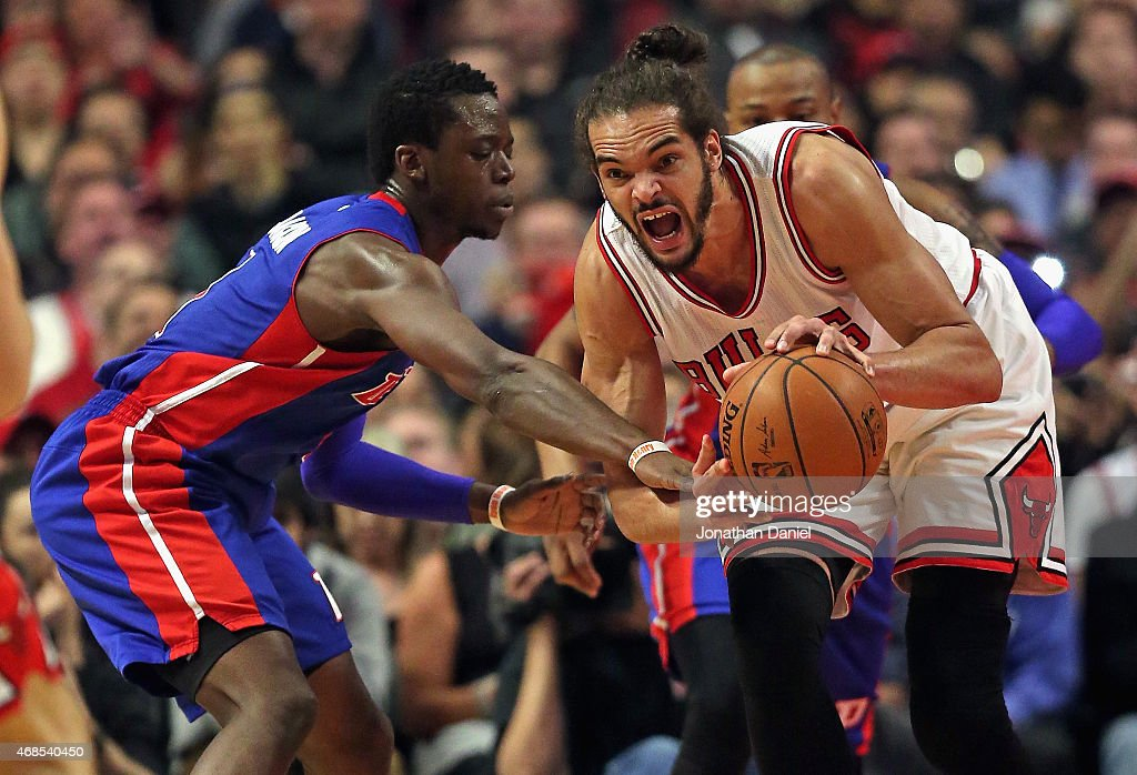 Joakim Noah #13 of the Chicago Bulls looks to pass under pressure from Reggie Jackson #1 of the Detroit Pistons at the United Center on April 3, 2015 in Chicago, Illinois.