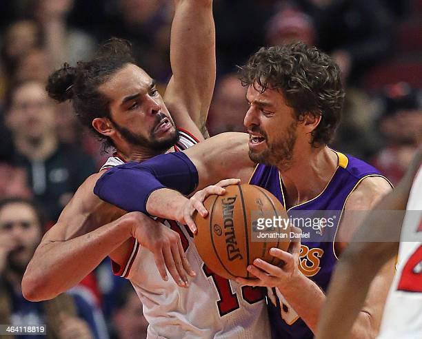 Joakim Noah of the Chicago Bulls pressures Pau Gasol of the Los Angeles Lakers at the United Center on January 20 2014 in Chicago Illinois The Bulls...