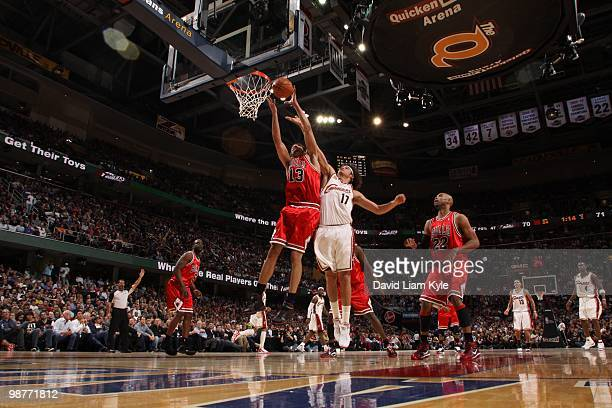 Joakim Noah of the Chicago Bulls pulls down a rebound against Anderson Varejao of the Cleveland Cavaliers in Game Five of the Eastern Conference...