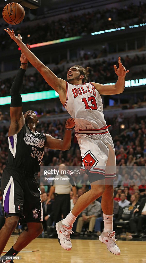 Joakim Noah #13 of the Chicago Bulls puts up a shot over Jason Thompson #34 of the Sacramento Kings on his way to a game-high 23 points at the United Center on October 31, 2012 in Chicago, Illinois. The Bulls defeated the Kings 93-87.