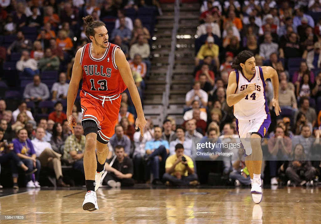 Joakim Noah #13 of the Chicago Bulls reacts after hitting a three point shot against the Phoenix Suns during the NBA game at US Airways Center on November 14, 2012 in Phoenix, Arizona. The Bulls defeated the Suns 112-106 in overtime.