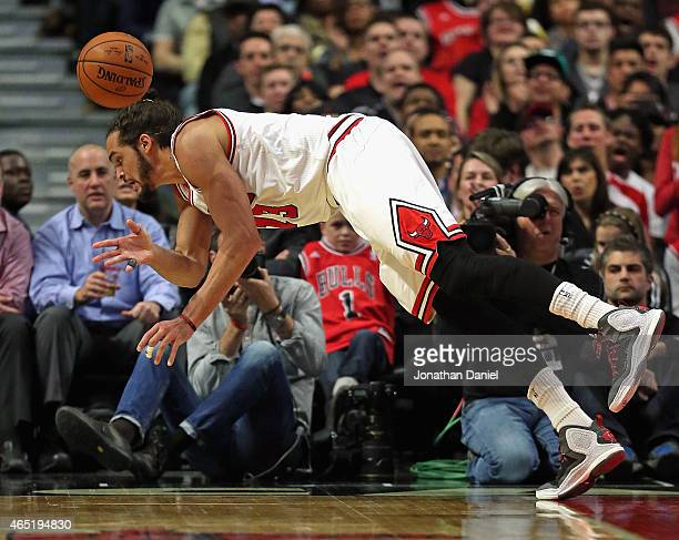 Joakim Noah of the Chicago Bulls saves the ball from going out of bounds against the Washington Wizards at the United Center on March 3 2015 in...