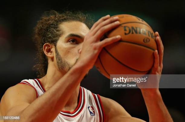Joakim Noah of the Chicago Bulls shoots a freethrow on his way to a gamehigh 23 points against the Sacramento Kings at the United Center on October...