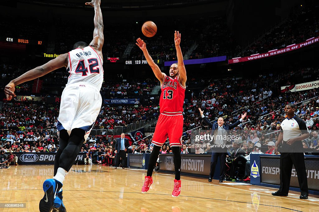 Joakim Noah #13 of the Chicago Bulls shoots against the Atlanta Hawks on April 2, 2014 at Philips Arena in Atlanta, Georgia.