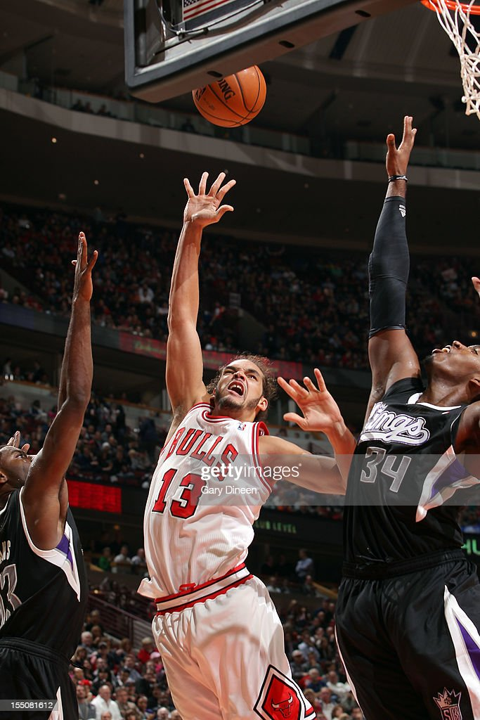 Joakim Noah #13 of the Chicago Bulls shoots against (L-R) Tyreke Evans #13 and Jason Thompson #34 of the Sacramento Kings during the NBA game on October 31, 2012 at the United Center in Chicago, Illinois.