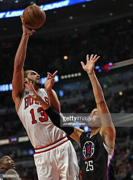 Joakim Noah of the Chicago Bulls shoots over Austin Rivers of the Los Angeles Clippers at the United Center on December 10 2015 in Chicago Illinois...