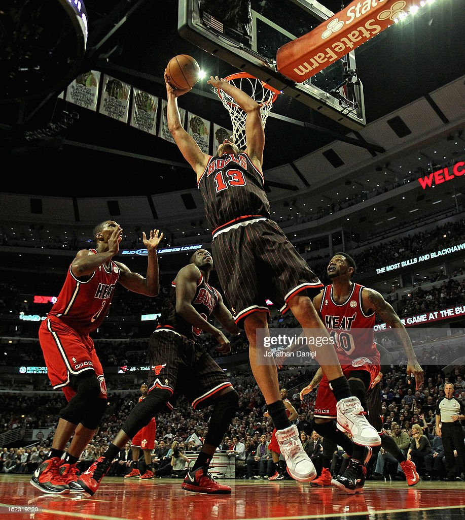Joakim Noah #13 of the Chicago Bulls shoots over teammate Loul Deng #9 and Chris Bosh #1 (L) and Udonis Haslem #40 of the Miami Heat at the United Center on February 21, 2013 in Chicago, Illinois. The Heat defeated the Bulls 86-67.